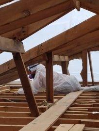 Asbestos abatement work in the attic