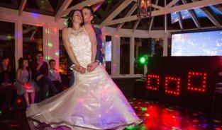 Bride & groom dancing photo
