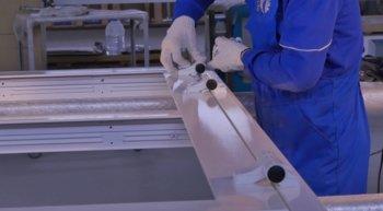 Aluminium worker putting together an aluminium door frame for a home installation