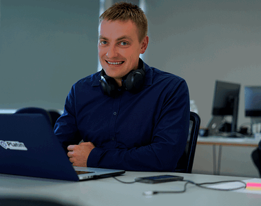 Vareger CTO Mykhailo Tiutin in company's office, smiling