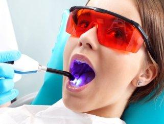 woman getting teeth whitening treatment