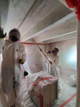 Asbestos crew working in containment