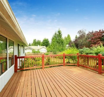 Wooden deck with a red timber fence built in the Southern Highlands, NSW