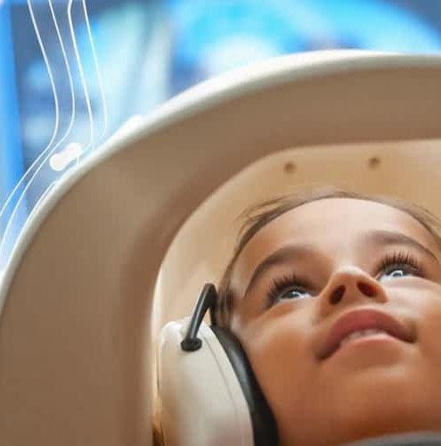 Smiling kid doing MRI
