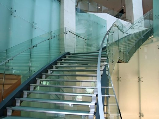 A building in the Sydney CBD that has a metal staircase with glass balustrade rails