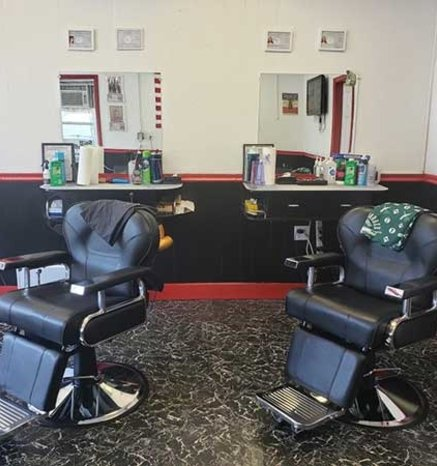Gentlemens Club inside of Barbershop image of barbering chairs